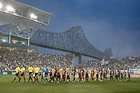 The Philadelphia Union and Houston Dynamo  come onto the field for pre-game introductions.  The Philadelphia Union and the Houston Dynamo played to a 1-1 tie during a Major League Soccer (MLS) match at PPL Park in Chester, PA, on August 6, 2011.