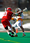 19 March 2011: University of Vermont Catamount Attacker Connor McNamara, a Freshman from Winchester, MA, is checked by Midfielder Brandon Ayers, a Sophomore from Lynbrook, NY of the St. John's University Red Storm at Moulton Winder Field in Burlington, Vermont. The Catamounts defeated the visiting Red Storm 14-9. Mandatory Credit: Ed Wolfstein Photo
