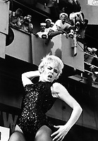 Watusi, Frug, Shimmy, Twist!  On a carrier? - It's swinging time on board Ticonderoga as Miss Joey Heatherton rocks out with a &quot;Tico Tiger&quot; during the Bob Hope Show.  (USIA)<br /> NARA FILE #:  306-MVP-8-6<br /> WAR &amp; CONFLICT BOOK #:  391