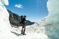 Ice climbers in beautifully coloured ice cave on Franz Josef Glacier,  Westland Tai Poutini National Park, West Coast, UNESCO World Heritage Area, South Westland, New Zealand, NZ