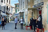 Street scene tourists shopping at St Martin de Re,  Ile de Re, France