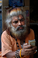 An Indian man text a message on his mobile phone in Mumbai. Telenor warned it could be forced to reconsider its presence in India if the New Delhi revises the terms of its spectrum licence amid a political scandal over regulation of the Indian telecoms industry.<br /> <br /> Unitech, since renamed Uninor, is one of five companies alleged to have benefited from irregularities that an official audit claimed had cost the Indian government $39bn in lost revenues from spectrum licences. <br /> <br /> <br /> Further reading : http://www.ft.com/cms/s/0/f391ebb0-33b4-11e0-b1ed-00144feabdc0.html#axzz1DWW1eUZh