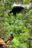 "Caves Branch, Belize, May 2012. The ""Mother of all Caves""... Actun Loch Tunich! Start with a vigorous hike up into the foothills of the Maya Mountains to the mouth of the cave.  The edge of the Actun Loch Tunich sink hole sits over 100 metres above the basin below,  above the rain forest canopy that grows out from the sink hole basin. To get down we abseil Adventure is what Ian Anderson's Caves Branch is all about. Over the years, the Caves Branch jungle lodge has evolved from extremely rustic Jungle River Camp with outhouses and bathing in the river to 5 Star Luxury Tree Houses with roof top decks and hot tubs to relax under the stars above. Photo by Frits Meyst/Adventure4ever.com"