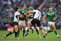 Jared Payne of Ireland takes on the Romania defence. Rugby World Cup Pool D match between Ireland and Romania on September 27, 2015 at Wembley Stadium in London, England. Photo by: Patrick Khachfe / Onside Images