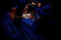 Young people play cards on a magazine in Tallinn, Estonia in Sept. 2009. The young democracy joined the European Union in 2004 and since has been working on getting the euro as its national currency. Estonia has one of the highest per capita incomes in central europe.