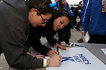 04 February 2015: Duke students line up to autograph a sign to be presented to Duke head coach Mike Krzyzewski (not pictured) after the game honoring him for his 1,000 career victory. The Duke University Blue Devils hosted the Georgia Tech Yellow Jackets at Cameron Indoor Stadium in Durham, North Carolina in a 2014-16 NCAA Men's Basketball Division I game.