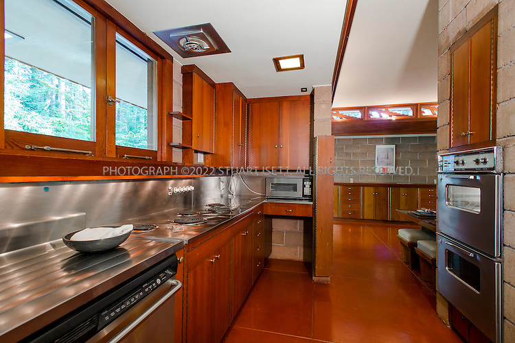 """10/9/2012--Sammamish, WA, USA..VIEW: Kitchen...Architect Frank Lloyd Wright planned his """"Usonian"""" homes to be affordable for middle-class families. The 1,9500 square foot Brandes home is for sale in Sammamish, Washington (30 minutes from Seattle) at $1.39 million. It features three bedrooms, two bathrooms and a small, separate office/study space...The home was built in 1952, and has redwood trim and Wright's original furniture and some garden sculptures by Wright. It's one of only three Frank Lloyd Wright homes near Seattle...©2012 Stuart Isett. All rights reserved."""