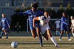 29 November 2013: Duke's Natasha Anasi (4) and Virginia Tech's Jazmine Reeves (5). The Virginia Tech University Hokies played the Duke University Blue Devils at Thompson Field in Blacksburg, Virginia in a 2013 NCAA Division I Women's Soccer Tournament Quarterfinal match. Virginia Tech won the game 3-0.