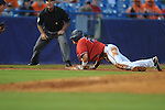 Ole Miss' Taylor Hashman slides safely into third and scores when he avoids the tag by Auburn's Ryan Jenkins during the Southeastern Conference tournament at Regions Park in Hoover, Ala. on Friday, May 28, 2010.  (AP Photo/Oxford Eagle, Bruce Newman)