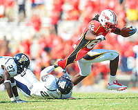 Torrey Smith of the Terrapins has his jersey grabbed by an FIU defender.  Maryland defeated FIU 42-28 during a game at Capital One Field at Byrd Stadium in College Park, MD on Saturday, September 25, 2010. Alan P. Santos/DC Sports Box