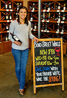 Portrait photography of Ashlee Cuddy with Bond Street Wines, taken inside the 7th Street Public Market in Uptown Charlotte, North Carolina. Building upon the success of Charlotte's Center City Green Market, the Seventh Street Public Market opened in 2012 to be a year-round market serving and celebrating local food artisans, entrepreneurs and local and regional farmers. Image is part of a series of photos taken of the Center City attraction.