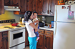 Mimi Ocampo dances with her younger daughter, Meli, in the kitchen of her apartment in London, Ky., after lunch on Friday, Oct. 26, 2012. Ocampo speaks in Spanish with her children and sings them songs by Spanish artists, like Enrique Iglesias. When she still lived in Oaxaca, Mexico, she would go to parties and dance every weekend, Ocampo said. | Photo by Taylor Moak