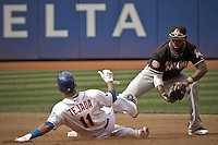 New York Mets shortstop Ruben Tejada (L) is tagged out by Miami Marlins shortstop Jose Reyes at second during their game at Citi Field Stadium in New York. Photo by Eduardo Munoz Alvarez / VIEW.