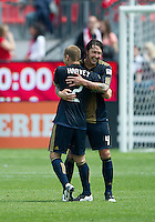 Philadelphia Union defender Jordan Harvey #2 and Philadelphia Union defender Danny Califf #4 embrace at the end of an MLS game between the Philadelphia Union and the Toronto FC at BMO Field in Toronto on May 28, 2011..The Philadelphia Union won 6-2..
