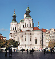 St Nicholas Church, built 1732-37 in Baroque style by the architect Kilian Ignaz Dientzenhofer, with 2 steeples and a large octagonal dome, Old Town Square or Staromestske namesti, Prague, Czech Republic. The historic centre of Prague was declared a UNESCO World Heritage Site in 1992. Picture by Manuel Cohen