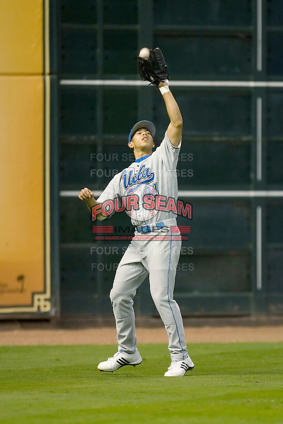Left fielder Gabe Cohen #44 of the UCLA Bruins setlles under a fly ball versus the Rice Owls in the 2009 Houston College Classic at Minute Maid Park February 27, 2009 in Houston, TX.  The Owls defeated the Bruins 5-4 in 10 innings. (Photo by Brian Westerholt / Four Seam Images)