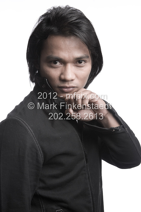 """Slug: WK/JAA.Date: 08-18-2006.Photographer: Mark Finkenstaedt FTWP.Location; The Ritz Carlton. Georgetown. Washington, DC.Caption: Tony Jaa Thai Martial Arts Movie Star promotes """" The Protector""""....© 2006 Mark Finkenstaedt. All Rights Reserved. Usual Post terms. LATimes WP News Service OUT unless under special arrangement with the photographer. No thrid party sales, loans or trades. Contacts; 703-237-8887 .  mark@mfpix.com"""