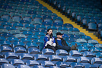 Two Sheffield Wednesday fans looking forlornly down from the main stand at Hillsborough after the final whistle of the crucial last-day relegation match against Crystal Palace. The match ended in a 2-2 draw which meant Wednesday were relegated to League 1. Crystal Palace remained in the Championship despite having been deducted 10 points for entering administration during the season.