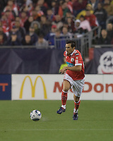 SL Benfica defender César Peixoto (25) brings the ball forward. SL Benfica  defeated New England Revolution, 4-0, at Gillette Stadium on May 19, 2010.