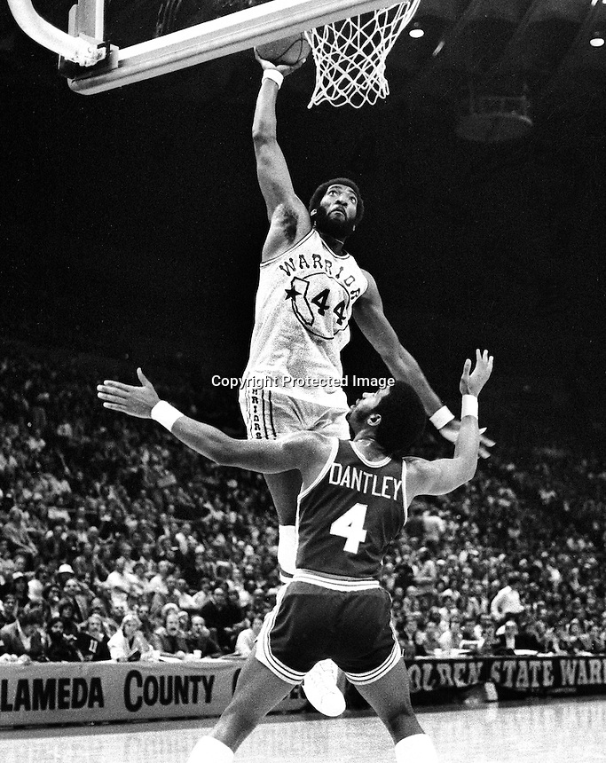 Golden State Warrior Clifford Ray shoots over Indiana Pacers Adrian Dantley...(1977 photo/Ron Riesterer)