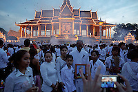 Family takes a photo after the coffin of the former king Norodom Sihanouk entered the Royal Palace in Phnom Penh October 17, 2012. Tens of thousands poured into Cambodia's capital to witness the procession on Wednesday of the body of Sihanouk, a revered figure who ruled through the triumph of independence to the tragedy of its brutal civil war. Mourners dressed in white lined the 10-km (6-mile) route to welcome the return of Sihanouk, the flamboyant former monarch who died at 89 of heart failure on Monday in Beijing, his residence since abdicating eight years ago. REUTERS/Damir Sagolj (CAMBODIA)