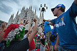 MILAN, ITALY - JUNE 14:  Italian fans cheer at their National team while watching the match Italy vs Paraguay on the maxi screen in Piazza del Duomo on June 14, 2010 in Milan, Italy. Italy's national football team managed a draw 1-1 against Paraguay in their first match of FIFA 2010Soccer World Cup.