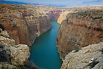 The Bighorn River flowing through the Bighorn Canyon in Montana. Colorful cliff walls above the river.