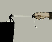 Unequal tug of war between small man and large hand at the edge of cliff