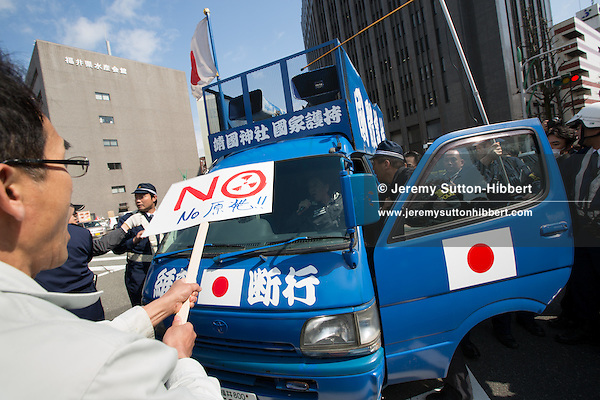 Fukui, Japan, April 14, 2012: Greenpeace activists greet Japanese Economy, Trade and Industry Minister Yukio Edano outside the Fukui Prefecture Government offices with a banner reading EDA*NO* (no nuclear), slamming the Governments push to bring two reactors at the Ohi nuclear power plant back online against public opinion and the recommendations of numerous experts, and despite essential safety and emergency upgrades not being completed. Japan currently has only one nuclear reactor out of 54 online, and will potentially be completely nuclear-free within one month. Greenpeace is calling on the Japanese government to leave its nuclear plants offline to ensure safety following the March 11, 2011 earthquake, tsunami, and triple meltdown at the Fukushima Daiichi nuclear plant, and to rapidly increase its renewable energy capacity.