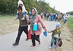 Refugees and migrants--including entire families--walk through the Hungarian town of Hegyeshalom on their way to the border where they will cross into Austria. Hundreds of thousands of refugees and migrants flowed through Hungary in 2015, on their way from Syria, Iraq and other countries to western Europe.