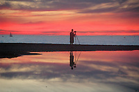 Photographer Yves Rubin, 46, captures sunset images at Santa Monica Beach on Saturday, January 2, 2010.