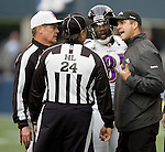 Baltimore Ravens head coach Jim Harbaugh, right, confers with Referee Scott Green, left, and head linesman Tom Stabile (24)  in the second quarter against the Seattle Seahawks at  CenturyLink Field in Seattle, Washington on November 13, 2011. The Seahawks beat the Ravens 22-17. ©2011 Jim Bryant Photo. All Rights Reserved.