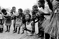 Mozambique. Province of Maputo. Manhiça is a small town (80 km north of the capital Maputo). A group  of girls sing, clap their hands and rehearse their dance a day before the feast for the official opening of hospital. The town can only be reached by plane. Beacause of the war between the Government and the rebel of the Frelimo party, the roads are either mined or too dangerous to travel on. The airplane is ran by the non governmental organisation (ngo) Médecins Sans Frontières (MSF) of Switzerland which has rehabilitated the local hospital.  © 1992 Didier Ruef