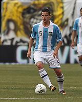 Argentina midfielder Fernando Gago (5) brings the ball forward. In an international friendly (Clash of Titans), Argentina defeated Brazil, 4-3, at MetLife Stadium on June 9, 2012.