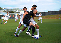 Team Wellington captain Bill Robertson holds off Cam Howieson during the Oceania Football Championship final (second leg) football match between Team Wellington and Auckland City FC at David Farrington Park in Wellington, New Zealand on Sunday, 7 May 2017. Photo: Dave Lintott / lintottphoto.co.nz