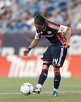 New England Revolution midfielder Lee Nguyen (24) passes the ball. In a Major League Soccer (MLS) match, Toronto FC defeated New England Revolution, 1-0, at Gillette Stadium on July 14, 2012.