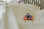 5 December 2014: Tucker West, sliding for the USA, crosses the finish line on his first run, ending the day with a 1st place finish and a combined 2-run time of 1:42.117 in the Men's Competition at the Viessmann Luge World Cup, at the Olympic Sports Track in Lake Placid, New York, USA. Mandatory Credit: Ed Wolfstein Photo *** RAW (NEF) Image File Available ***