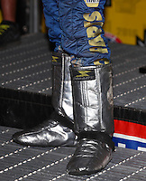 Nov 12, 2016; Pomona, CA, USA; Detailed view of the Impact brand fire boots of NHRA funny car driver Ron Capps celebrates after clinching the 2016 funny car world championship during qualifying for the Auto Club Finals at Auto Club Raceway at Pomona. Mandatory Credit: Mark J. Rebilas-USA TODAY Sports