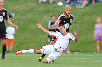 Diego Fagundez (14) of the New England Revolution gets fouled by Kyle Porter (19) of D.C. United. D.C. United defeated the The New England Revolution 3-1 in the Quarterfinals of Lamar Hunt U.S. Open Cup, at the Maryland SoccerPlex, Tuesday June 26 , 2013.