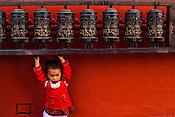 A young girl at Syambhunath Gompa in Kathmandu, Nepal. Photo: Sanjit Das/Panos