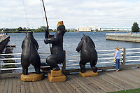 Fishing bears and friend at Sault St. Marie, Michigan.