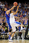 2 APR 2012: Center Jeff Withey (5) from the University of Kansas tries to gain control of a loose ball against forward Anthony Davis (23) from  the University of Kentucky during the Championship Game of the 2012 NCAA Men's Division I Basketball Championship Final Four held at the Mercedes-Benz Superdome hosted by Tulane University in New Orleans, LA. Kentucky defeated Kansas 67-59 to claim the championship title. Ryan McKeee/ NCAA Photos.