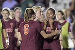 06 December 2013: Teammates console Virginia Tech's Jazmine Reeves (right) after the final whistle. The Florida State Seminoles defeated the Virginia Tech University Hokies 3-2 at WakeMed Stadium in Cary, North Carolina in a 2013 NCAA Division I Women's College Cup semifinal match.