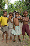 Milne Bay, Papua New Guinea; local village children run along with group and pose for pictures , Copyright © Matthew Meier, matthewmeierphoto.com