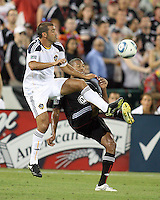 Jordan Graye #16 of D.C. United clashes with Alan Gordon #21 of the Los Angeles Galaxy during an MLS match at RFK Stadium on July 18 2010, in Washington D.C. Galaxy won 2-1.