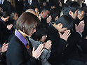 March 11, 2012, Rikuzentakata, Japan - People offer prayers in a religious service at a Buddhist temple in  Rikuzentakata, Iwate Prefecture, some 402 km northeast of Tokyo, on Sunday, March 11, 2012..Memorial ceremonies were held throughout Japan to mark the one year anniversary of the massive earthquake and tsunami that struck the country?fs northeastern region, killing just over 19,000 people and unleashing the world?fs worst nuclear crisis in a quarter century. The quake was the strongest recorded in the nation?fs history, and set off a tsunami that towered more than 65 feet in some spots along the northeastern coast, destroying thousands of homes and wreaking widespread destruction. (Photo by Natsuki Sakai/AFLO) AYF -mis-