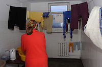 Chechen woman doing the laundry on the third floor of the URiC Radom refugee centre, in Poland..-For security reason, the face of the adult asylum seeker have been evicted of the photography..-For security reason, the names of the adult asylum seeker have been change. .-Article 9 of the Act of 13 June 2003 on grating protection on the Polish territory (Journal of Laws, No 128, it. 1176) personal data of refugees are an object of particular protection..-Cases where publication of a picture or name of asylum seeker had dramatic consequences for this persons and is family back in Chechnya. .Please have safety of those people in mind. Thank you.