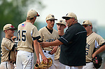 BEACON FALLS,  CT-051817JS28-Woodland head coach Mike Kingsley, talk with his players at the mound during their game against Wolcott Thursday at Woodland Regional High School in Beacon Falls. <br /> Jim Shannon Republican-American