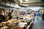 Southbury, CT- 23 April 2017-042317CM07-  Patrons browse through books during the Friends of the Southbury Public Library's annual Book Sale on Sunday.  All of the items in the sale were from donations, which featured thousands of books, DVD's, records and compact discs.  Approximately  2500 people came through the sale over the course of 4 days, said Edgar Mills vice chairman of the Friends of the Southbury Public Library.  Proceeds from the event will go towards various programs held at the library.  Christopher Massa Republican-American