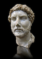 Roman portrait bust of Emperor Hadrian, 117-138 AD excavated from the S. Barbiana region near the Station Terminus, Rome. Hadrian ( Publius Aelius Hadrianus Augustus) was Roman Emperor from 117 to 138. An enthusiastic  builder Hadrian rebuilt the Pantheon and constructed the Temple of Venus and Roma as well as building Hadrian's Wall, which marked the northern limit of Roman Britain. His villa at Tivoli also showed Hadrian passion for water and Roman baths. Hadrian was regarded by some as a humanist and was philhellene in most of his tastes. He is regarded as one of the Five Good Emperors. The great love of his life was Antinous who died tragically and suspiciously when he drowned in the Nile.  The National Roman Museum, Rome, Italy